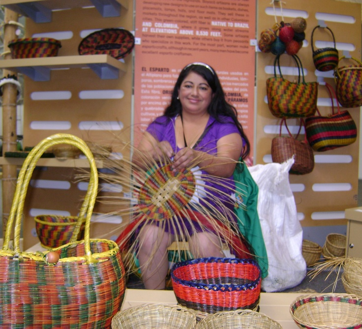 Colombian artisan making a basket with dried palm leave
