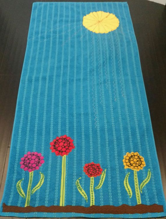 Appliqued beach towel with a Zen tangled sun by Curiousmakings
