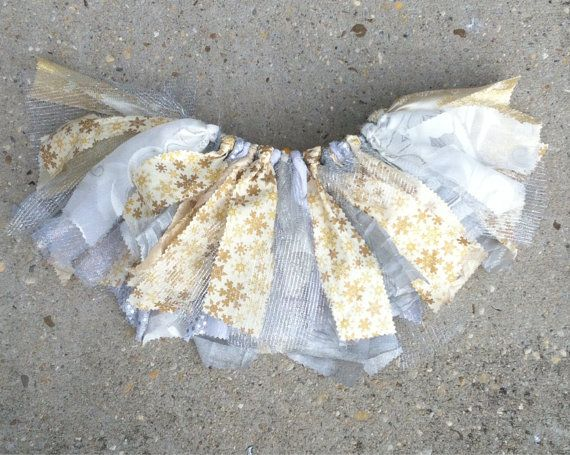 This elegant fabric and tulle tutu skirt is perfect for winter outings and photos! Its made on a ribbon that can be tied into a pretty bow.    Add a