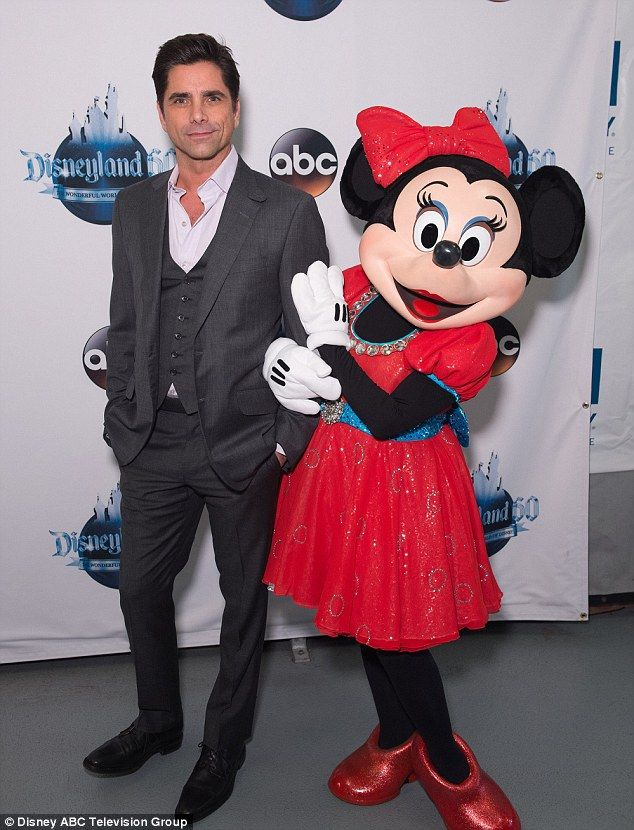 Suave: Fuller House star John Stamos wore a three-piece suit while posing with Minnie Mouse
