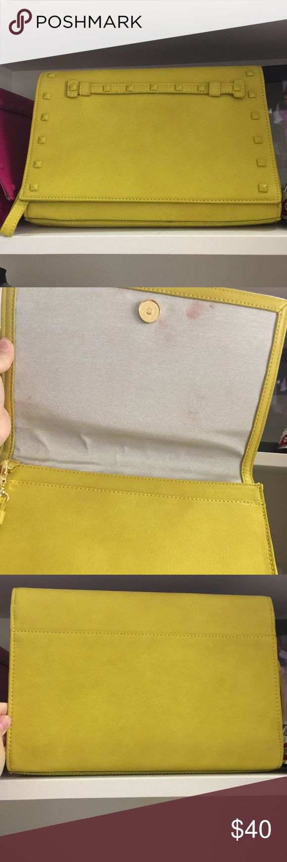 Yellow studded clutch Very similar to the rockstud Valentino clutch. Has some smears on the inside flap. Also selling the other two colors Bags Clutches & Wristlets