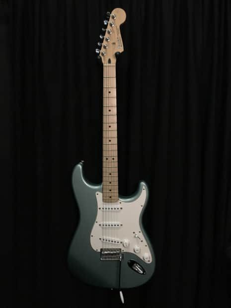 Used Fender Standard Mexican Stratocaster in the rare Sage Green finish. Guitar has some small scratches and dings on the body. There are also some swirl scratches on the pickguard and some light fret wear on the first few frets. GUITAR IS ON THE FLOOR HERE AT OUR STORE AND WILL SHOW SIGNS OF SLI...