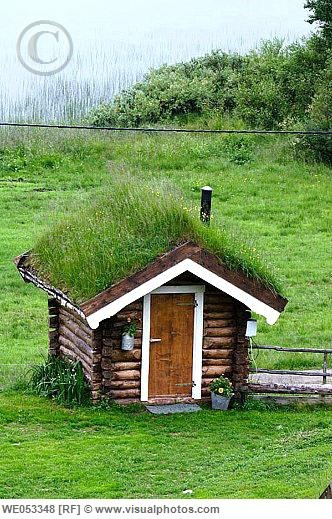 Small sauna-house with grass-roof, belonging to a traditional farm. Lake Rauvatnet, Fjell near Mo i Rana, Nordland, Lapland, Norway, Scandinavia, Europe. [WE053348]