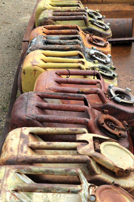 Rusty vintage gas cans