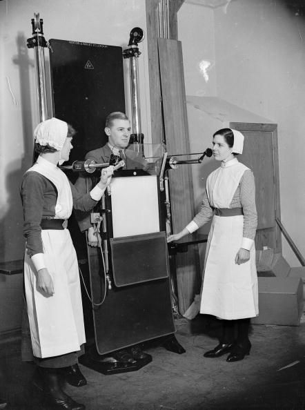 A nurse and sister with an Xray machine used to identify chest ailments in the new paying patients wing at University College Hospital in London, 15th December 1936.