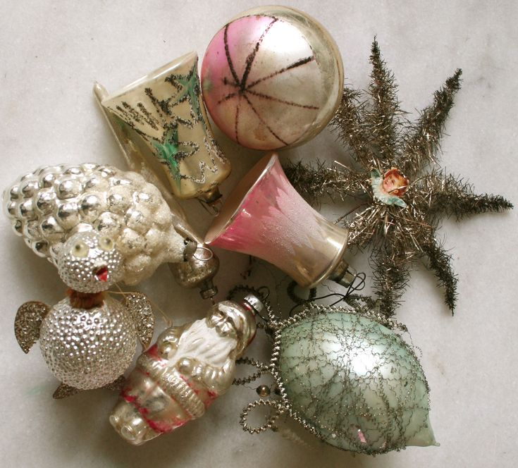 These are what ornaments looked like before WWII probably from Germany 1920-1940.  The black portions are silver and they have become tarnished.  Giltter as we know it had not been invented.