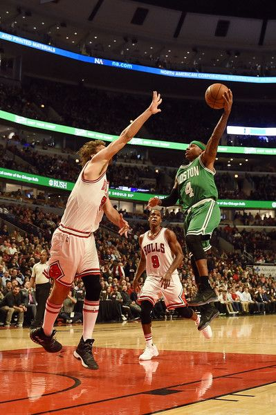 Robin Lopez Photos - Isaiah Thomas #4 of the Boston Celtics shoots over Robin Lopez #8 of the Chicago Bulls during the first half of a game at the United Center on October 27, 2016 in Chicago, Illinois. NOTE TO USER: User expressly acknowledges and agrees that, by downloading and or using this photograph, User is consenting to the terms and conditions of the Getty Images License Agreement. - Boston Celtics v Chicago Bulls