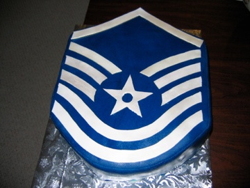 Promotion party cake in the shape of the rank