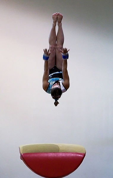 Gymnast performing on vault exercise (2007).