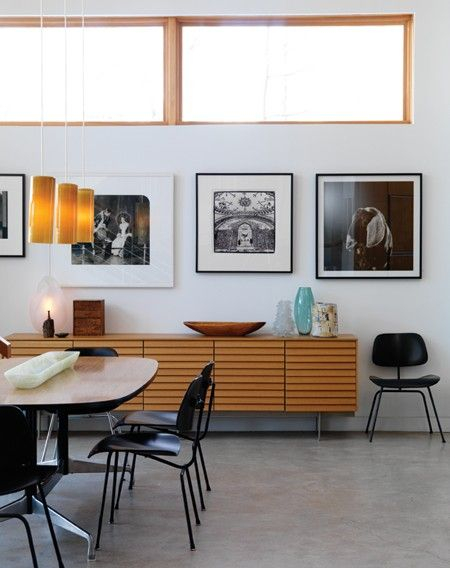 Concrete floor and cool credenza. Room design by Peter Fleming. Photo by Stacey Brandford. From Canadian House & Home May 2009 issue. Credenza from Kiosk furniture.