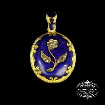 Victorian Cobalt Blue Enamelled Locket This locket is bordered with fine scroll engraving with a central flower motif inset with diamonds, both locket and bale are inlaid with cobalt blue enameling, circa 1870.