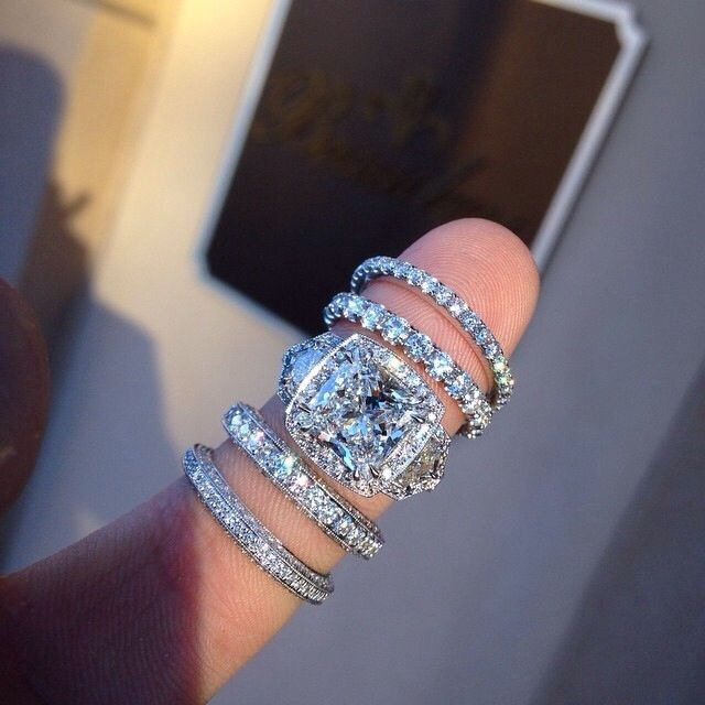We love this gorgeous engagement ring and diamond wedding bands!