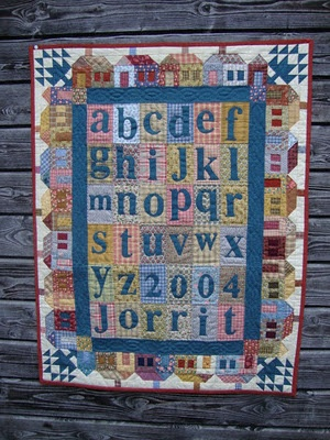 quilt --hand made and the letters were appliqued