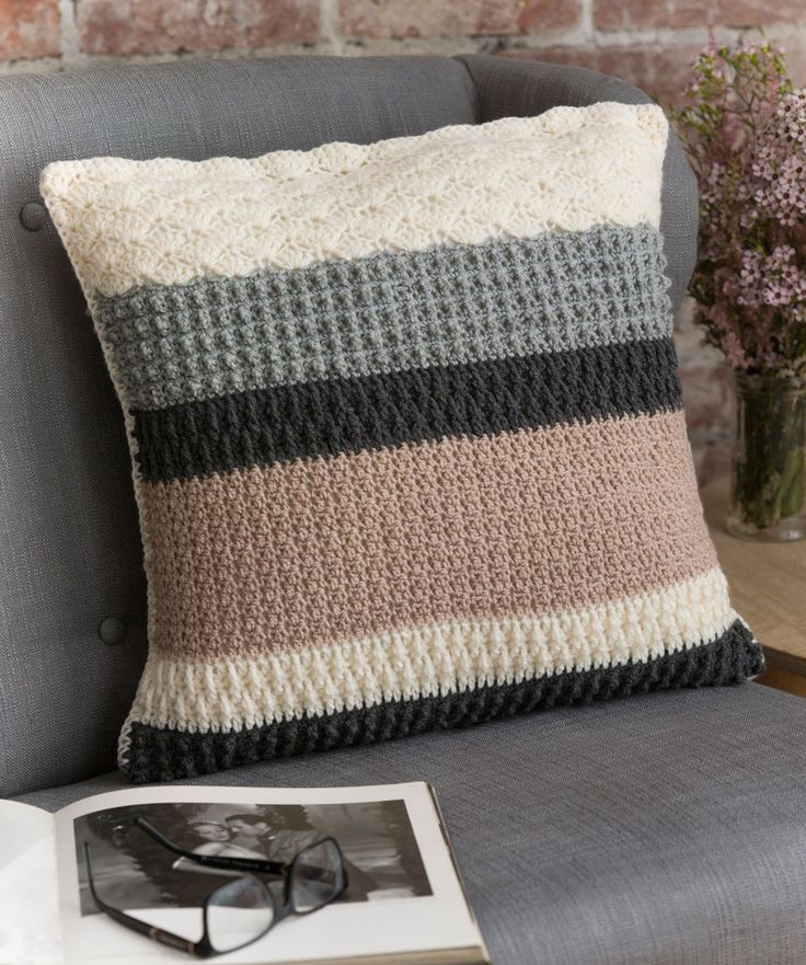 Change textures as you change colours on this sophisticated crocheted pillow. We used neutral shades here, but choose shades to suit your décor.