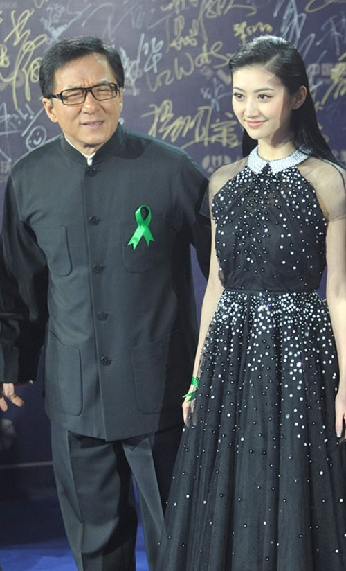 """Jackie Chan, Liu Ye, Jing Tian and the other casts of the film """"Police Story 2013"""" attend the closing ceremony of the 2013 Beijing International Film Festival in Beijing, April 23, 2013. The festival closed on Tuesday."""