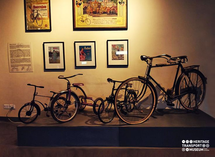 Group of cycles displayed with vintage cycle advertisements, portraying the freedom of women on wheels!  #advertisements #cycle #vintagecollection