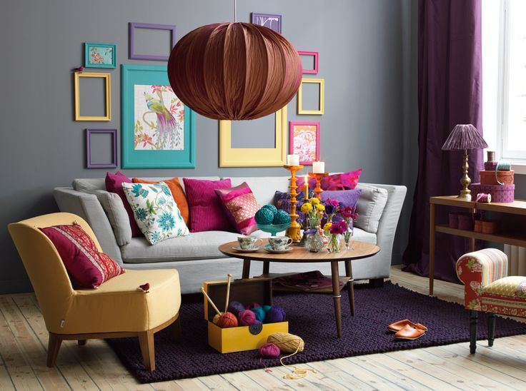 Loooove all the color. Gray walls + gray couch, yet bright and cheery!: