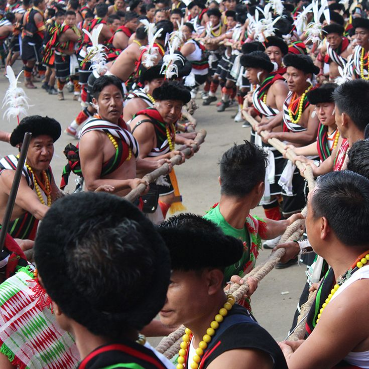 Angami tribe lined up along the streets of Kohima, for the Mononolith Pulling event. The large stone monolith is pulled through Kohima with the combined strength of the Angami men