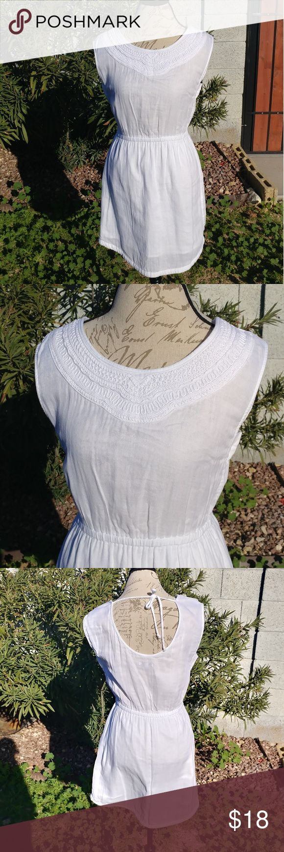 "Casual white GAP dress Very good condition.  Sleeveless, 100% cotton dress.  Measures: Waist flat 14"" (stretchy) Bust flat 17.5""  Length (the longest side) 35"" GAP Dresses Mini"