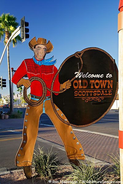 Old Town Scottsdale - Galleries, shops galore . . . twelve foot greeter at corner of Scottsdale Rd. & Main Street . . . by famous cowboy artist Monte Flagg.