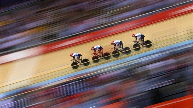 Geraint Thomas, Steven Burke, Edward Clancy, and Peter Kennaugh of Great Britain post a new world record time during men's Team Pursuit Track Cycling Qualifying on Day 6.