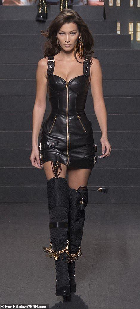 Bella Hadid sizzles in leather mini-dress on Moschino X H&M catwalk