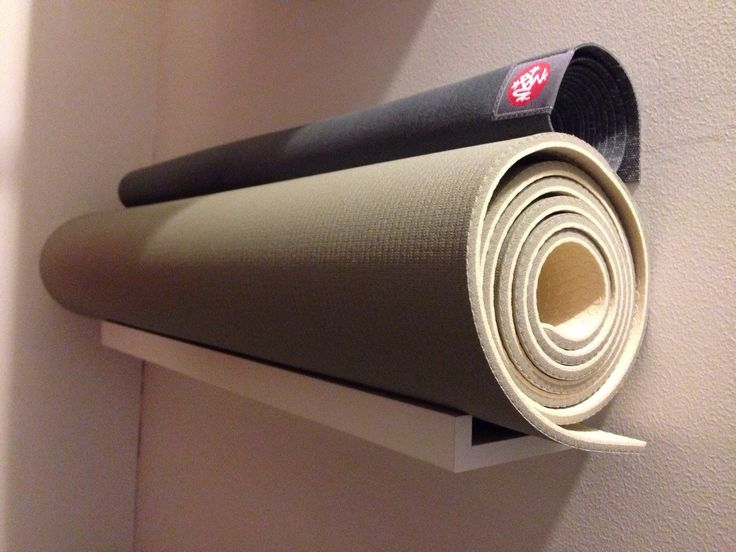 I just created a new yoga mat storage spot in my closet from a picture ledge shelf - Imgur