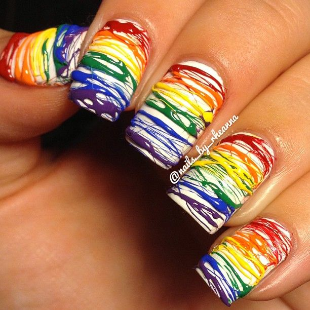 this looks so amazing! another piece that looks like someone literally took art and put it on someones fingers! the lines look so neat and perfect and rainbow is such a popular trend now a days!  10/10 so inspired!