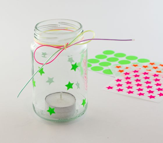 DIY: decorate an empty jar with stickers and put a little light in it!