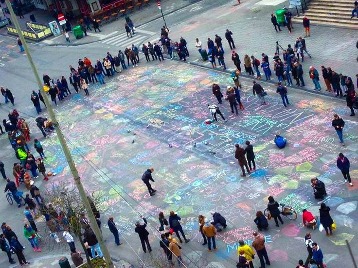 People's At Brussel's Writing Their Messages And Prayers With Chalk.
