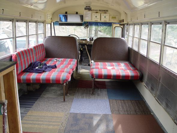 rotate bus seats to make seating against the window walls