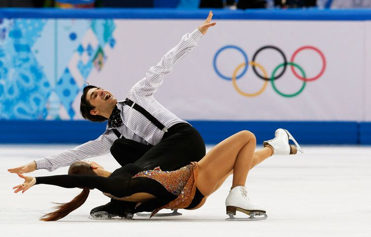 9 jaw-dropping photos that will make you believe in ice dancing - The Week - Turkey: Alisa Agafonova and Alper Ucar. | (REUTERS/Alexander Demianchuk)