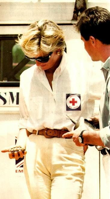 January 15, 1997: Diana, Princess of Wales tours a minefield dressed in a flak jacket and face shield in Huambo, central Angola. The Princess was visiting Angola for the Red Cross, to see for herself the carnage mines can cause.: