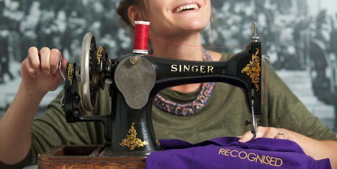 Lucy Bissett from Museums Galleries Scotland with a Singer sewing machine dating from the 1920s