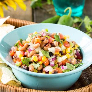 Served chilled, this Texas Caviar Dip with black-eyed peas, black beans, corn, and red bell pepper is wonderful eaten with tortilla chips or on its own.