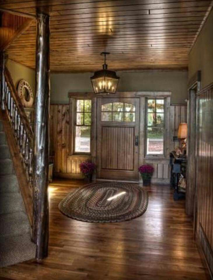 LOVES: wood on the ceiling!, front door and surround, wood stair post, light fixture