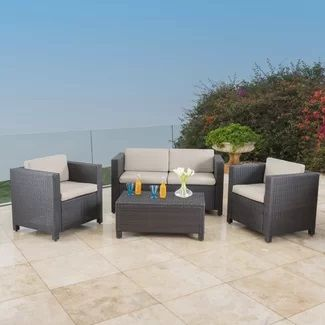 Outdoor Wicker Patio Furniture! We love wicker furniture outside on a patio, balcony, porch, or in tight spaces.