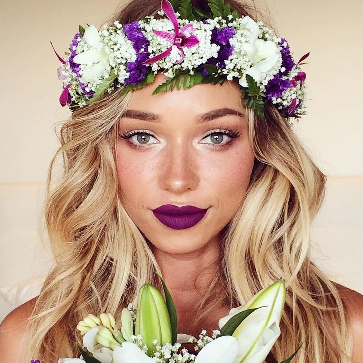 Pop of purple lip color.