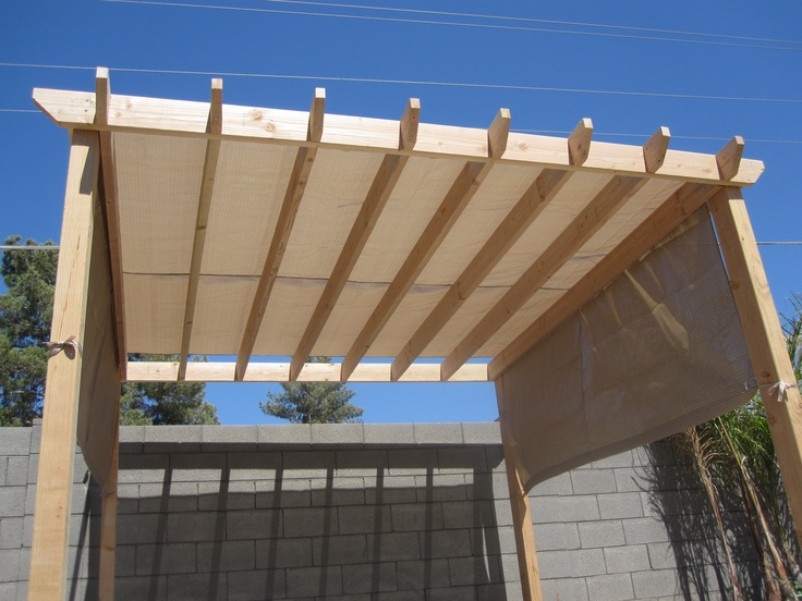 Beautiful Backyard Pergola With Beige Colored Canvas Tarp
