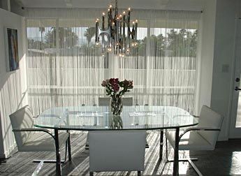 Dining room with net curtains