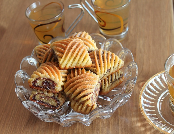 Makroud - Moroccan semolina and butter cookies filled with dates, fried and dipped in honey.