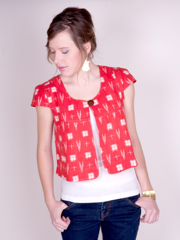 Hand woven Ikat print cropped jacket. Contrasting block print lining. Cap sleeve.