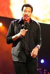 """Lionel Brockman Richie, Jr. (born June 20, 1949) is an American singer-songwriter, musician, record producer and actor. From 1968, he was a member of the musical group Commodores signed to Motown Records. Richie made his solo debut in 1982 with the album Lionel Richie and number-one hit """"Truly""""."""