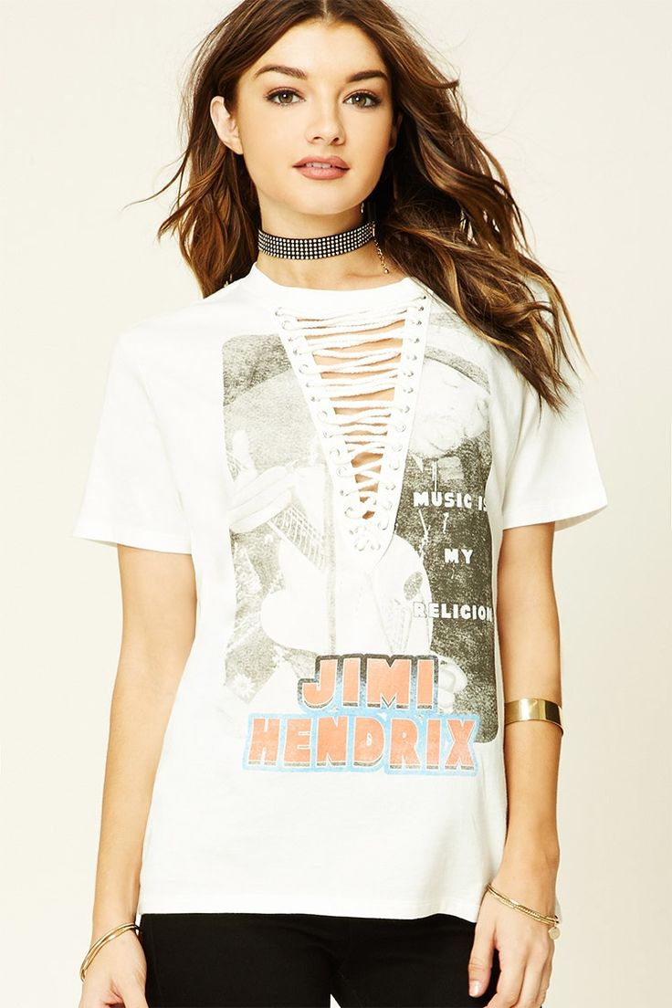 """A knit tee featuring a Jimi Hendrix and """"Music Is My Religion"""" graphic on the front, a lace-up front with grommets, short sleeves, and a round neckline."""