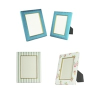 Gorgeous new luxury photo frames from Cubbins... available in silk, tweed, wool and all kinds of patterns and designs...