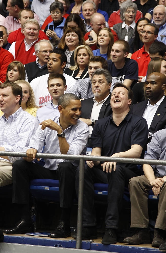 President Barack Obama and British Prime Minister David Cameron chat during one of the NCAA basketball tourney games at UD Arena in Dayton, Ohio 3/13/12. Photo by Ty Greenless/Dayton Daily News.