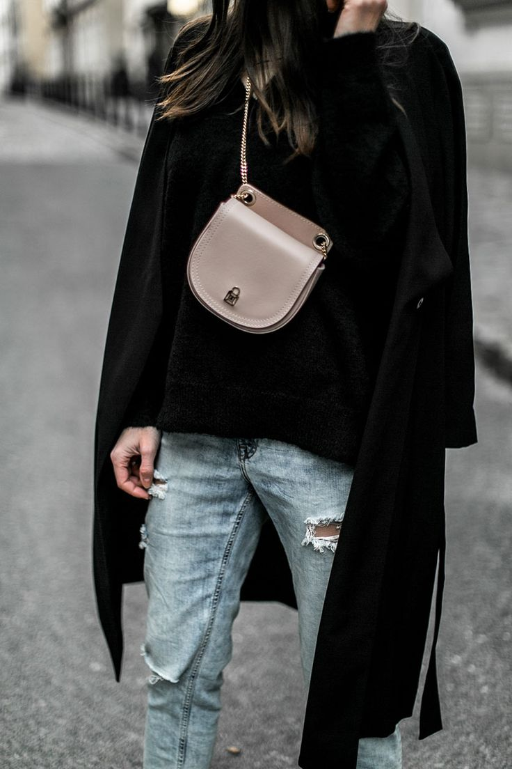 belt bags are bag in 2017 and will stay for 2018. light pink fanny pack from patrizia pepe worn with light blue mom jeans and black jumper and coat