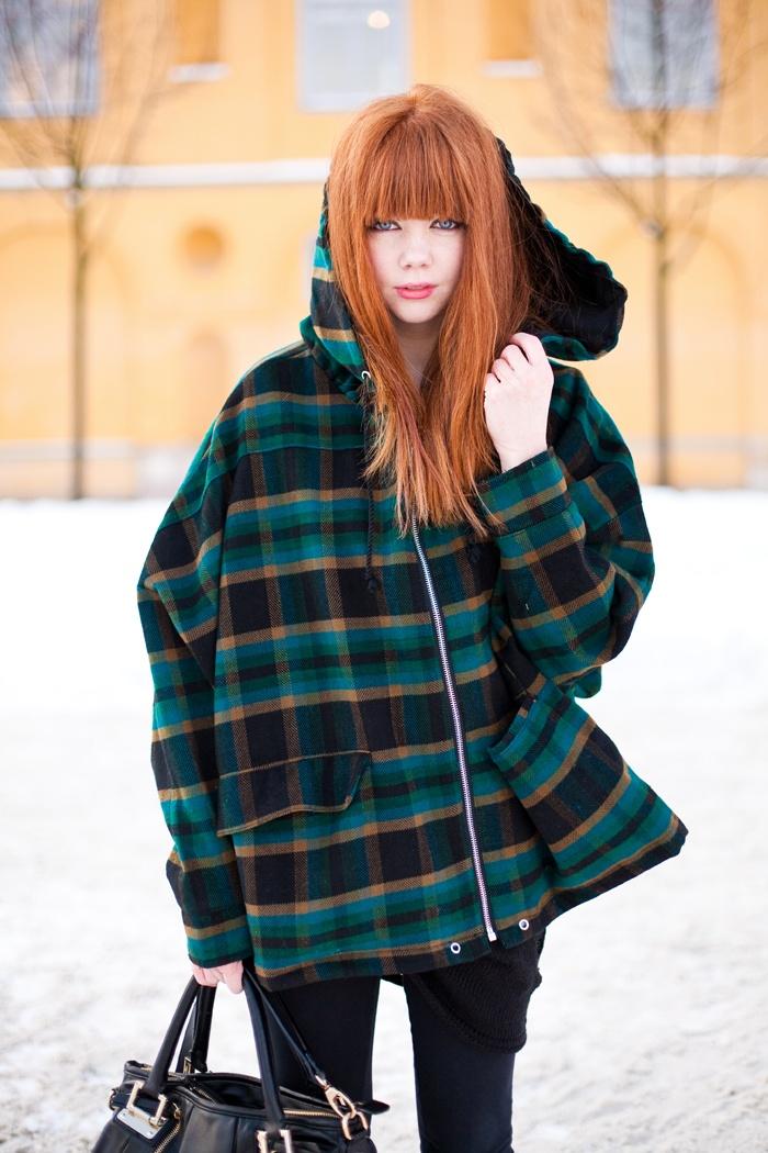turqouise coat and orange hair