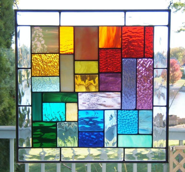 Stained glass panel window rainbow geometric abstract stained glass window panel (g3) suncatcher. $89.00, via Etsy.