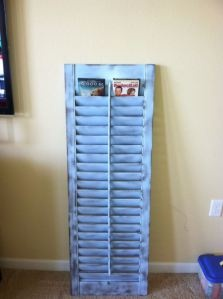 Old shutter, painted, antiqued, and re-purposed to be a DVD holder!